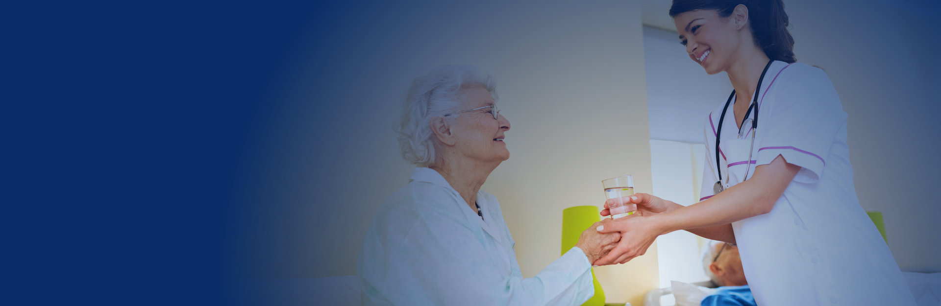Doctor giving her patient a glass of water