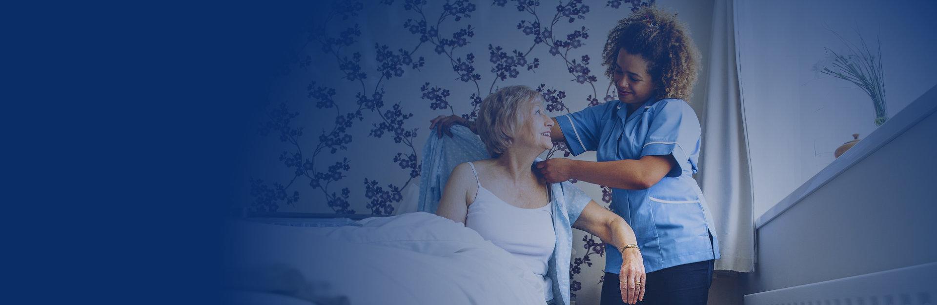 Caregiver asssisting the elder to get dressed