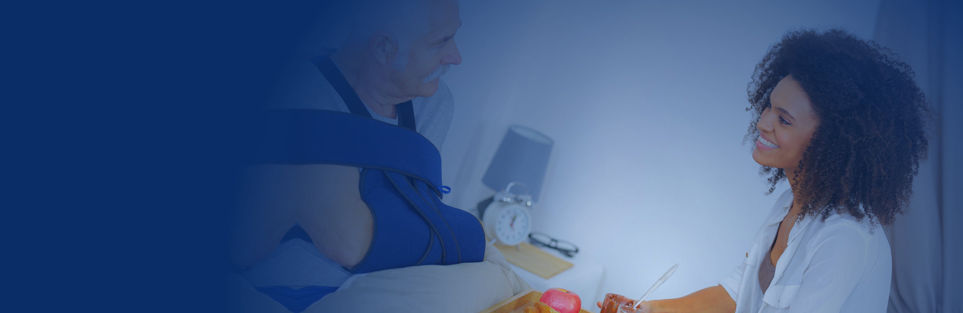Caregiver is serving meal to her patient