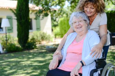 Homecarer and elderly in garden